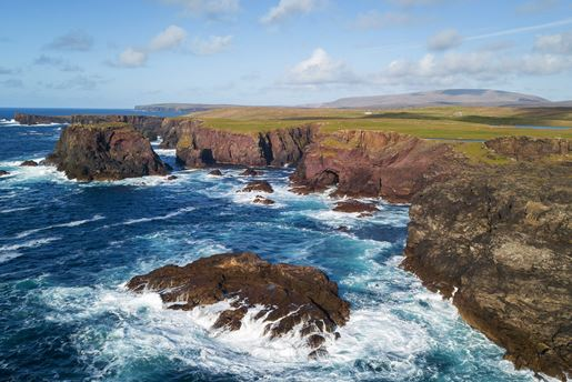 The rocky Eshaness Cliffs on a sunny day in Shetland in Scotland