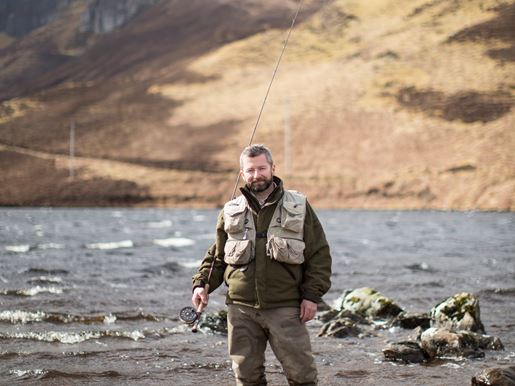 Ghillie Mitchell Partridge fly fishing in the river at Kinloch Lodge in the Scottish Highlands