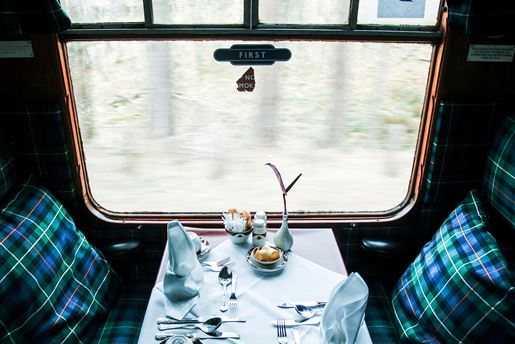 A table set in a a train carriage travelling through Scotland