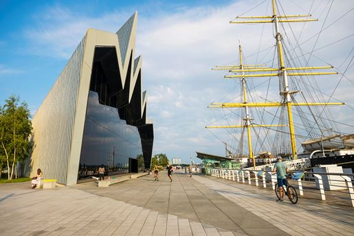 The Riverside Museum and boats on river in Glasgow in the Scottish Lowlands