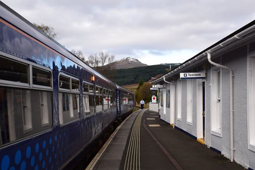 View of a train and the mountains at the station at Fort Augustus in the Highlands in Scotland